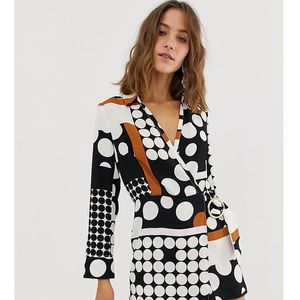 River Island wrap playsuit in spot print - Black
